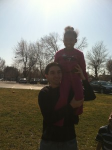 Jada on Mr. Chris's shoulders.