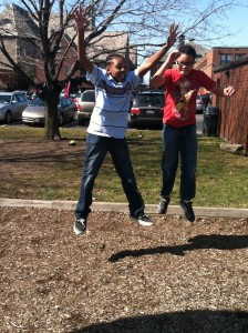 Joshua and Delmar jumping.